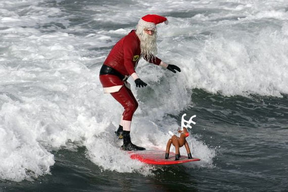 Surfing Santa Foamie Competition At Fistral Beach Newquay